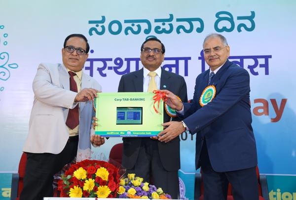 "Shri S R Bansal, Chairman & Managing Director of the Bank launching new product ""Corp Tab-Banking"" on the occasion of 110th Foundation Day Celebrations of the Bank in the presence of Shri Amar Lal Daultani and Shri B K Srivastav, Executive Directors of the Bank."
