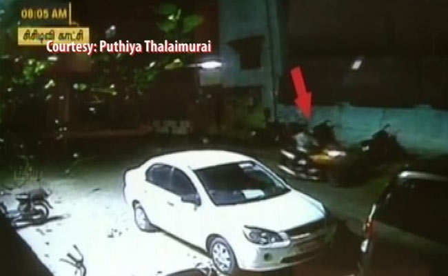 CCTV security camera footage showing the attackers hurling the crude bomb at a new channel office in Chennai.