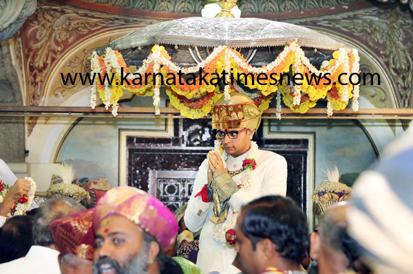 Yaduveer Krishnadatta Chamaraja Wadiyar seated on a silver throne during his coronation ceremony