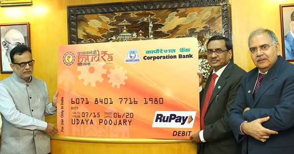 Dr. Hasmukh Adhia, IAS, Secretary, Dept. of Financial Services, Ministry of Finance, Govt. of India launching the First MUDRA Card in the presence of  Shri. S R Bansal.