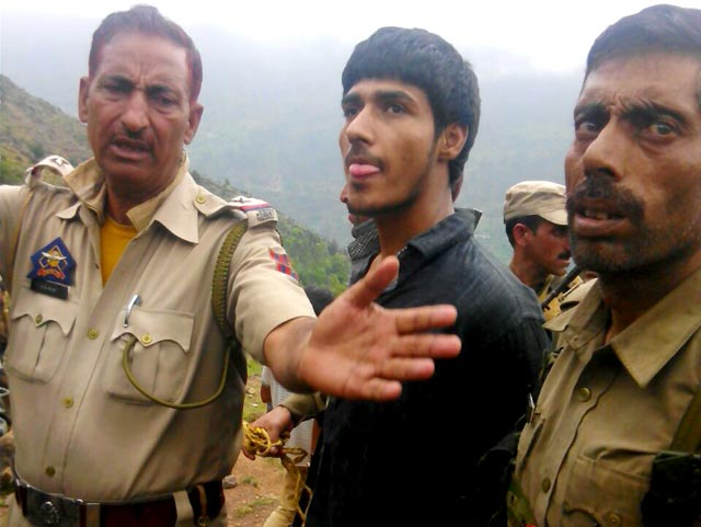 The militant captured (centre)was identified as Usman Khan and believed to be from Pakistan.