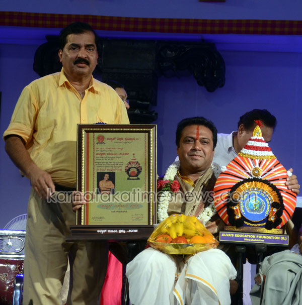 "Moodbidri, Nov 29, 2015: Sayyed Sallaudin Pasha felicitated ""Nudisiri Award"" in the field of cultural service at valedictory function of ""Alva's Nudisiri 2015, a four-day national event at Vidyagiri, Moodbidri near Mangaluru on Sunday, November 29. Syed Sallauddin Pasha is a Bharatanatyam and Kathak dancer, Choreographer, Actor and Founder Artistic Director of Ability Unimited, a therapeutic dance theater on Wheelchairs in India. Pic By R.K.Bhat/Mangalore/Karnataka/India."